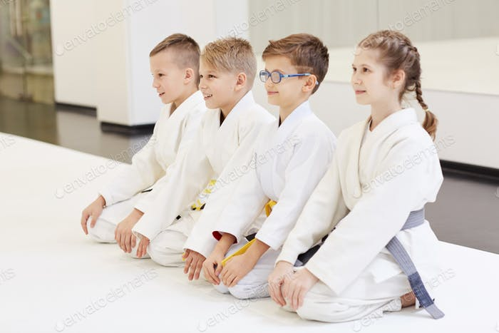 Young judoists doing judo