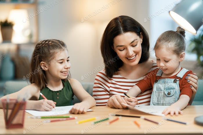 Mother and daughters are drawing together