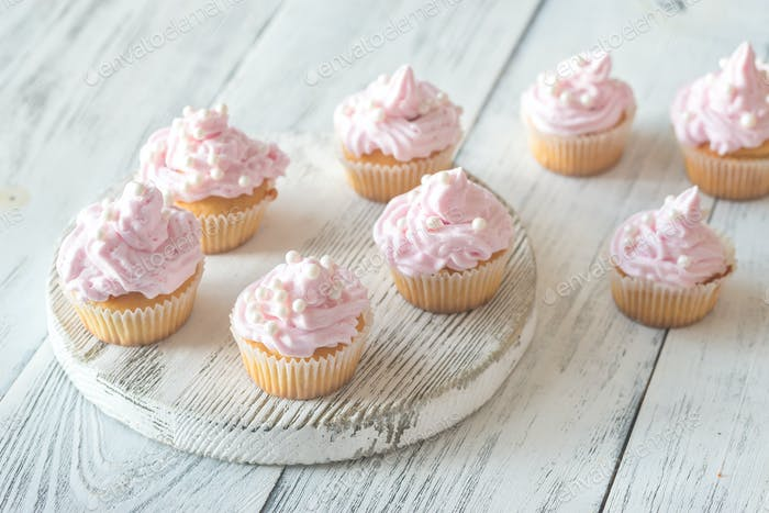 Many pink cream homemade cupcakes