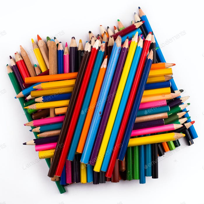 Many used colored pencils on top of each other
