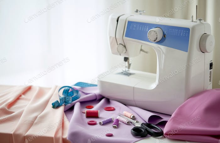 sewing machine, scissors, buttons and fabric