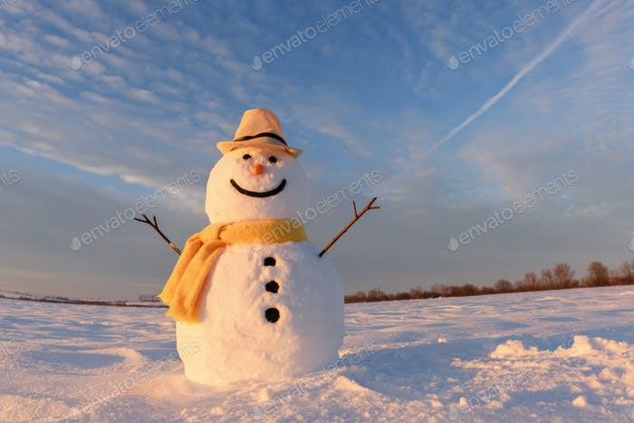 Funny snowman in yellow hat