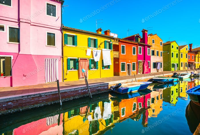 Burano island canal, colorful houses and boats,Venice, Italy