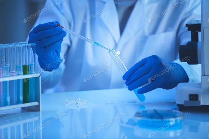 Unrecognizable Scientist Taking Specimen