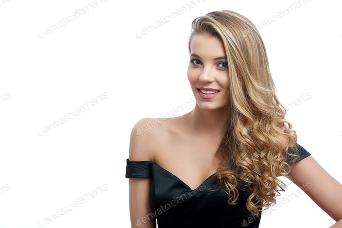 Portrait of a beatiful smiling girl with blonde hair on the white background