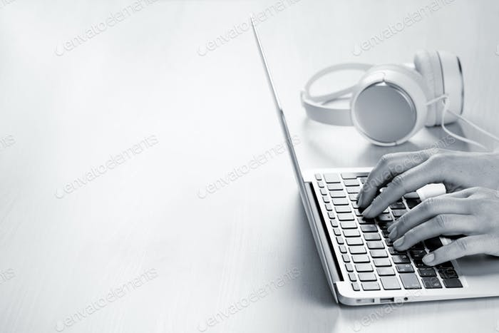 Woman working on laptop. Hands typing on keyboard.