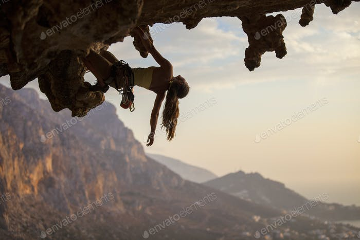 Female rock climber at sunset