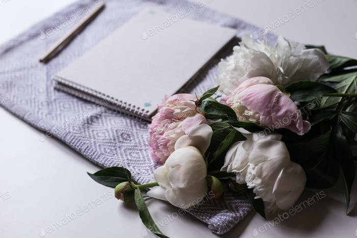 Notebook with bouquet peonies
