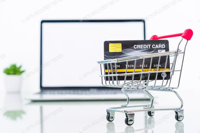 Credit card front of laptop and surgical mask-2