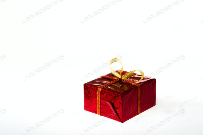 Gift box in colored box on a white background