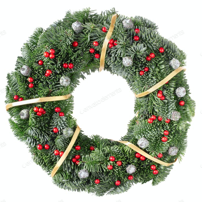 Christmas wreath with golden ribbon and red berries