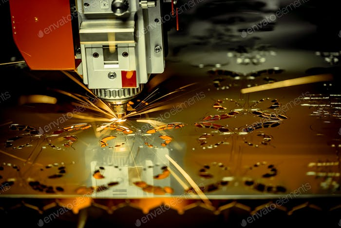 CNC Laser cutting of metal, modern industrial technology. .