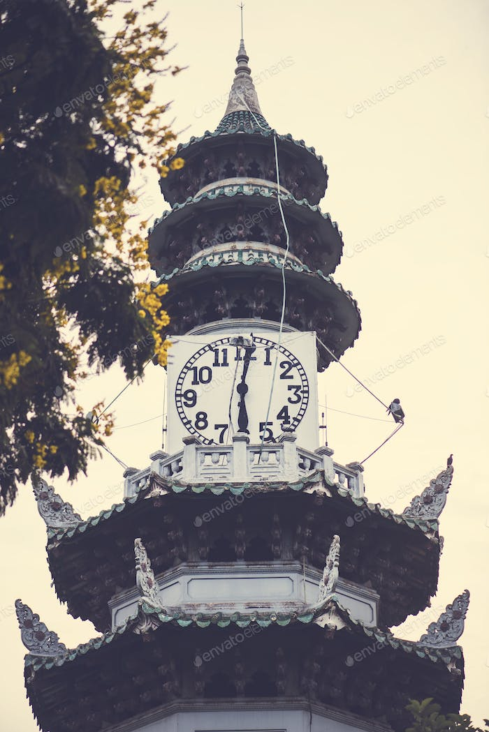 The clock tower at Lumphini Park in Bangkok