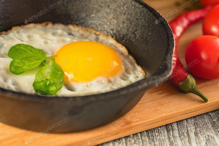 Fried eggs in a frying pan. Rustic breakfast