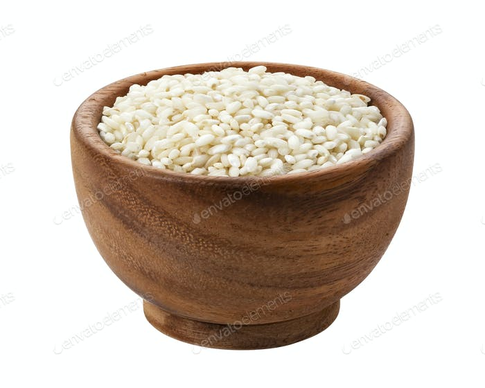 Risotto rice in wooden bowl isolated on white background