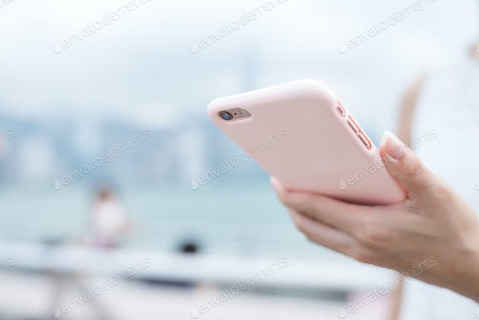 Woman surfing internet on cellphone