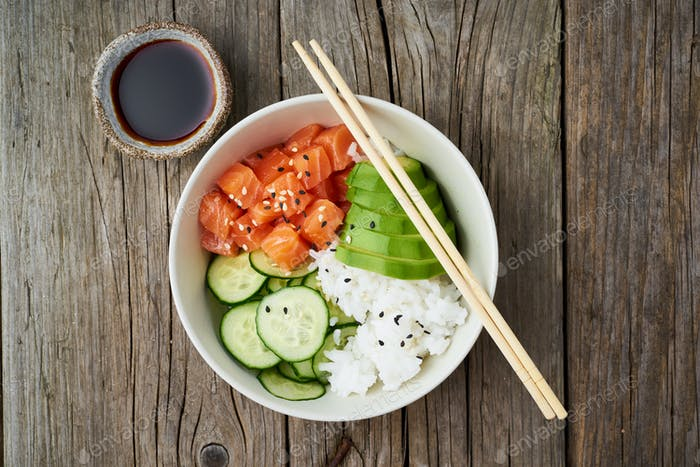 salmon poke bowl with fresh fish, rice, cucumber, avocado