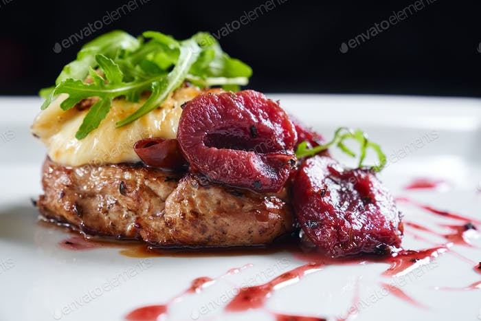 Beef served with plums, mozzarella and rucola