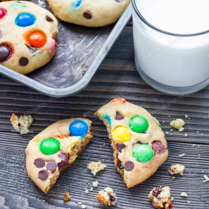 Shortbread cookies with multi colored candy and chocolate chips on metal tray, square