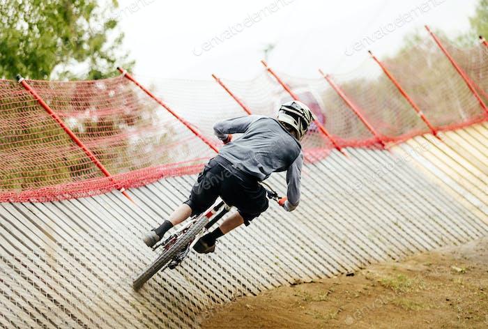 back athlete rider downhill