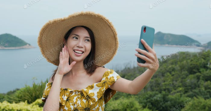 Travel woman take selfie on cellphone at countryside