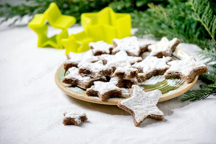 Star shape cocoa cookies with white glaze. Christmas decorations. Copy space