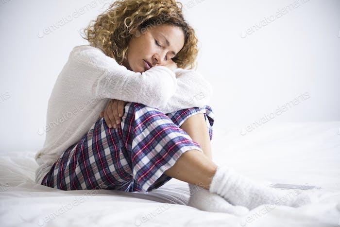 Beautiful sweet caucasian adult woman hug herself and protect