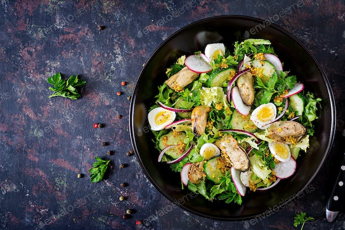 Dietary salad with mussels, quail eggs, cucumbers, radish and lettuce