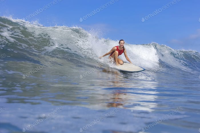 Female surfer on a wave