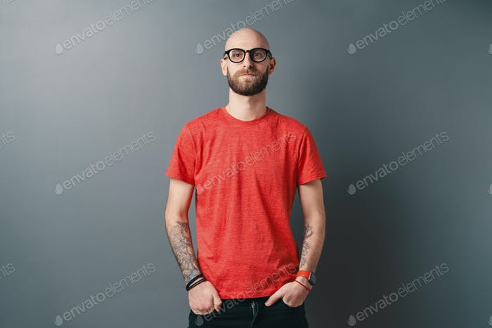 Stylish young man posing in the studio on gray background