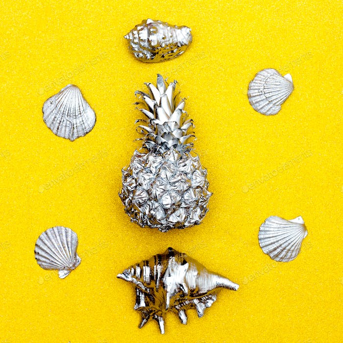 Tropical set. Pineapple and seashells on a gold background. Mini