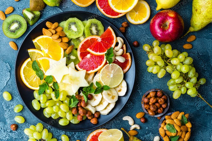 Healthy vegetarian bowl dish with fresh fruits and nuts