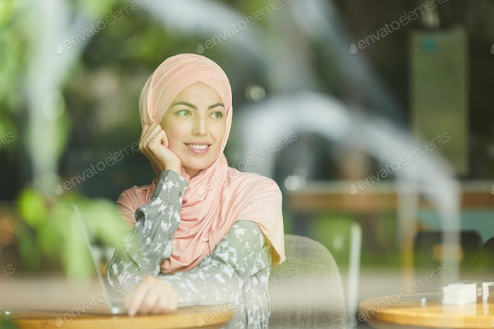 Muslim businesswoman in restaurant