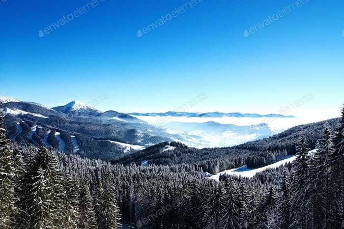 mountain landscape with peaks covered by snow and clouds