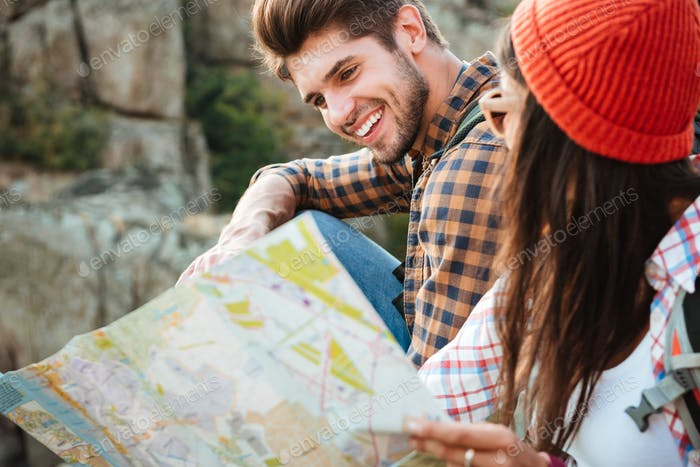 Cropped image of adventure couple with map