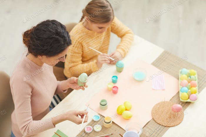 Mother and Daughter Painting Easter Eggs Together