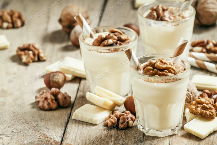 Dessert of white chocolate and walnuts, selective focus