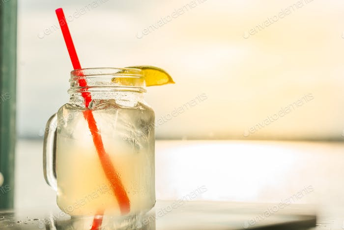 Close up of moscow mule with lime and red straw