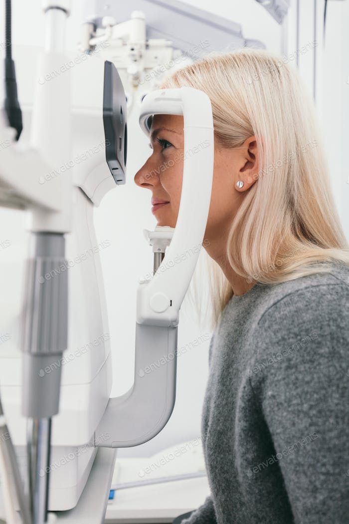 Woman taking eyesight test at optician's office.