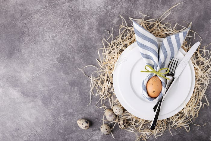Easter Table Setting on Stone Background with Copy Space.