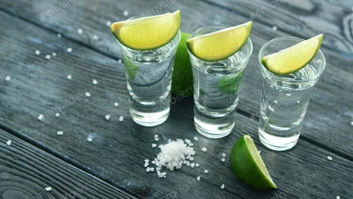 Served glass shots with tequila