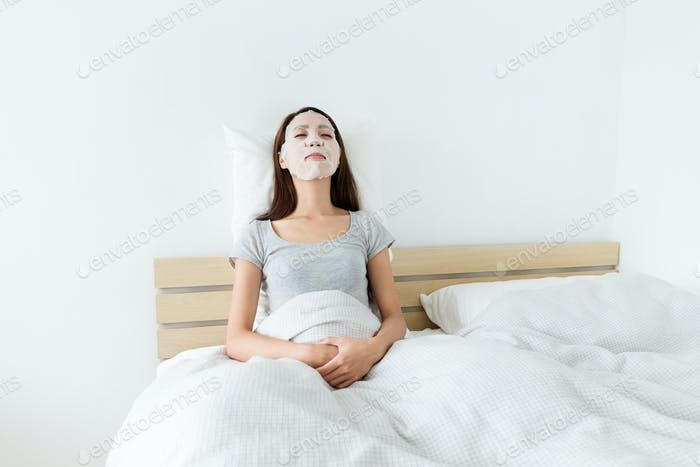Woman sleeping on bed and do masking
