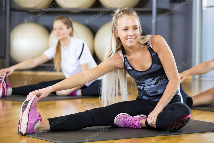 Woman Looking Away While doing Stretching Exercise