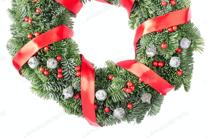 Christmas wreath with red satin ribbon and berries