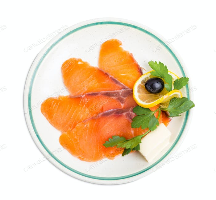 Delicious sliced salmon with lemon.