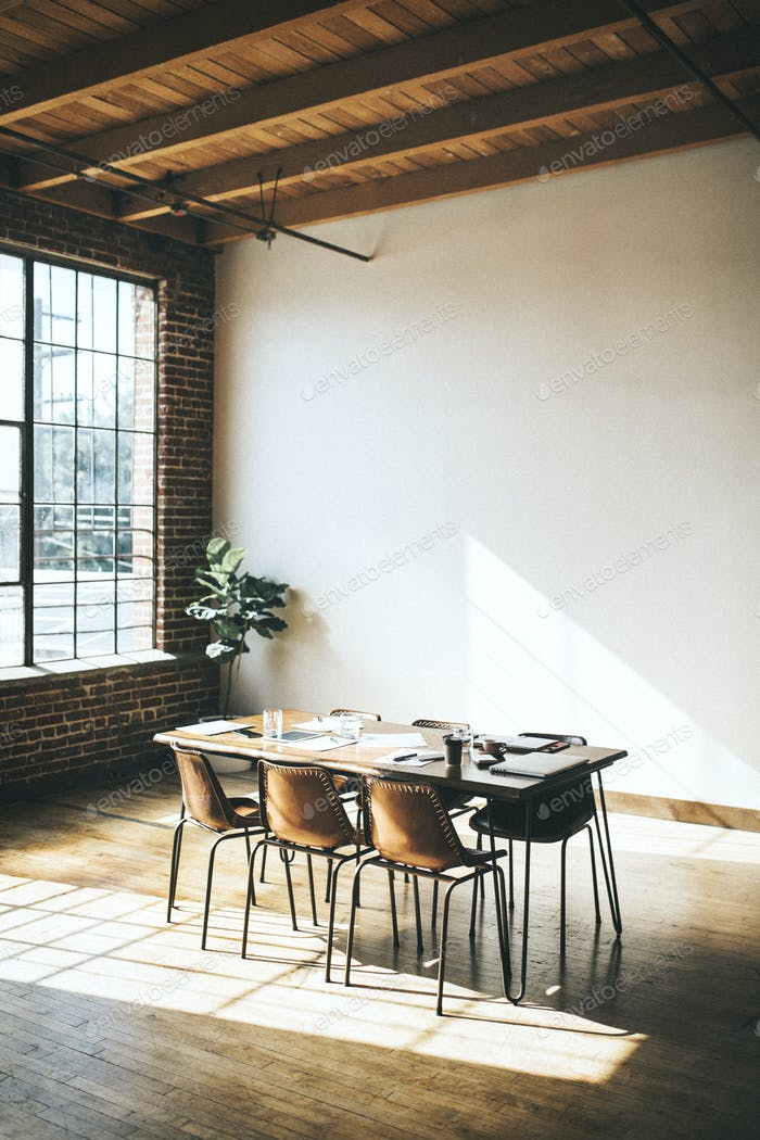 Empty meeting room with natural sunlight