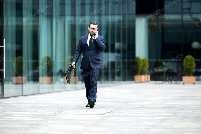 Business man going near office building