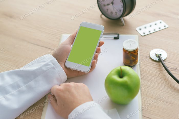 Doctor advising apple instead of pills and antibiotics