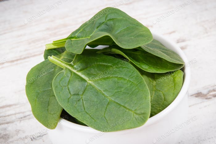 Green spinach as source natural minerals, vitamins and fiber, healthy nutrition concept