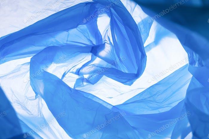 Pattern of blue trash bag over white background